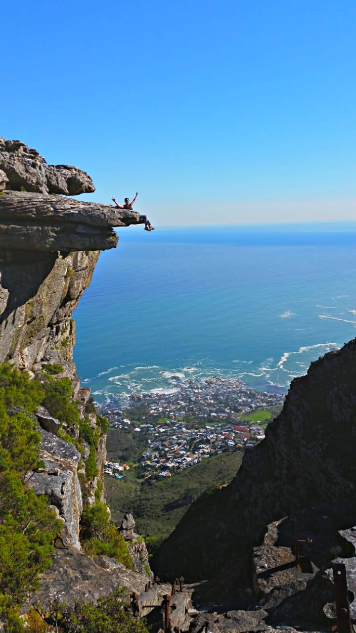 Maretha posing on the Surfboard Rock on Table Mountain - Kasteelspoort Hike