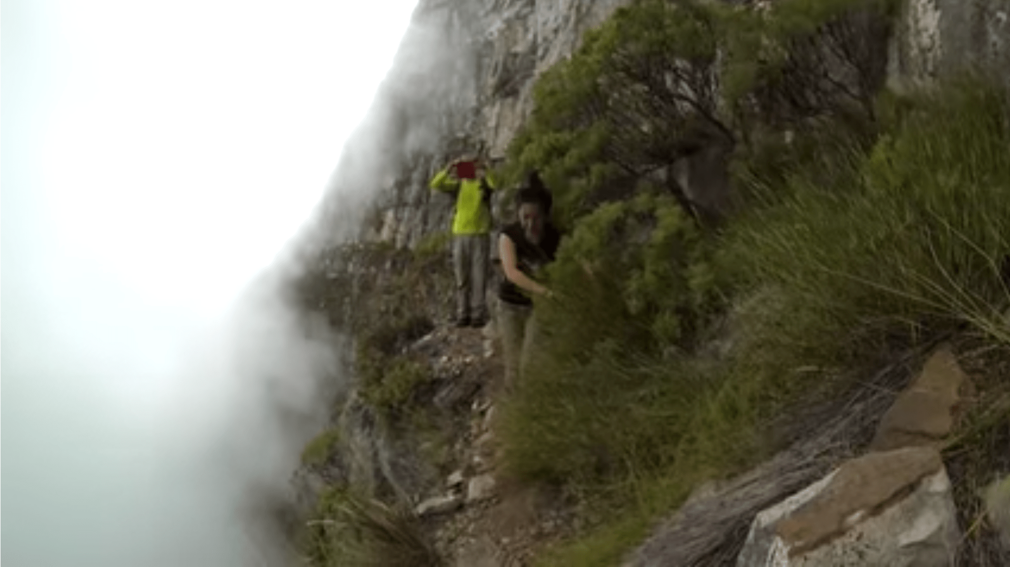 Yi-Jia Susanne Hou in thick fog on the Arrow Face Traverse, Table Mountain